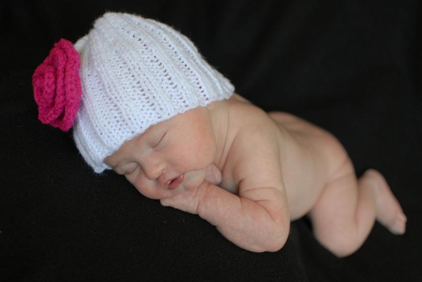 newborn baby girl wearing hat