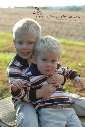 brothers posing by a cornfield