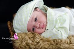 baby boy in a basket