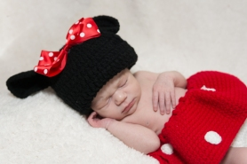 newborn girl wearing minnie mouse outfit