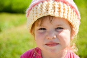 child with crocheted hat