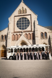 wedding party in front of catholic church and trolley