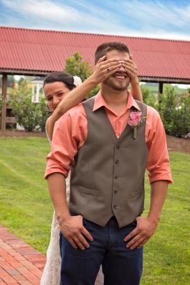 Bride covering grooms eyes before he sees her