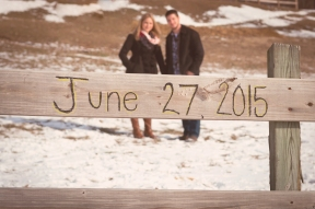engagement photo with date on wooden fence in millersville, pa