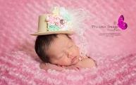 newborn girl wearing lady gaga hat