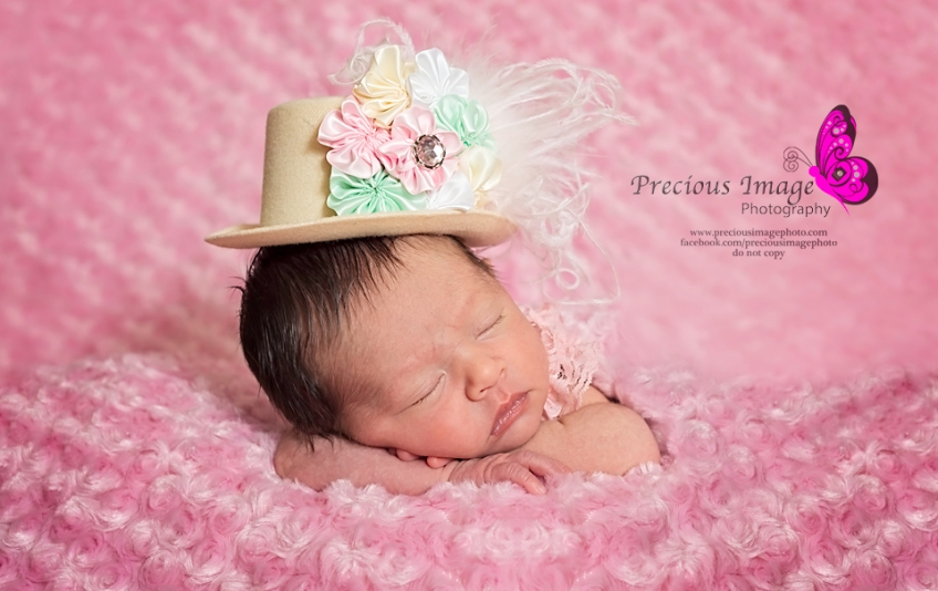newborn girl wearing lady gaga hat