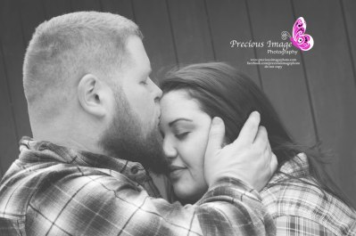 man kisses woman in engagement photo
