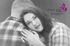 gorgeous couple in front of red barn for engagement session