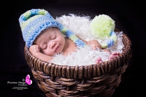 baby smiling in a basket