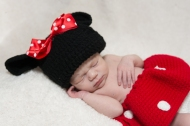 baby girl wearing crocheted mini mouse outfit