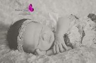 newborn girl wearing lace romper