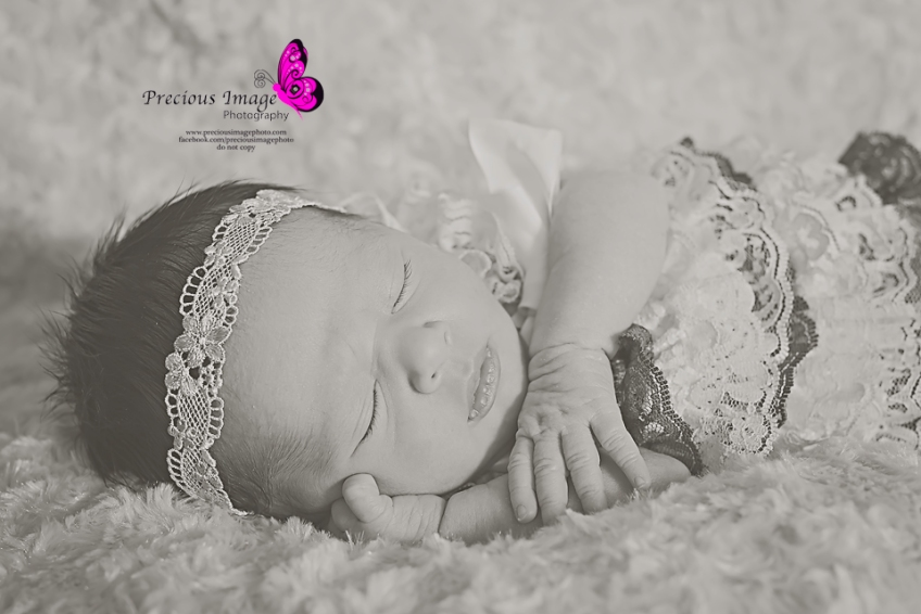newborn girl wearing lace romper
