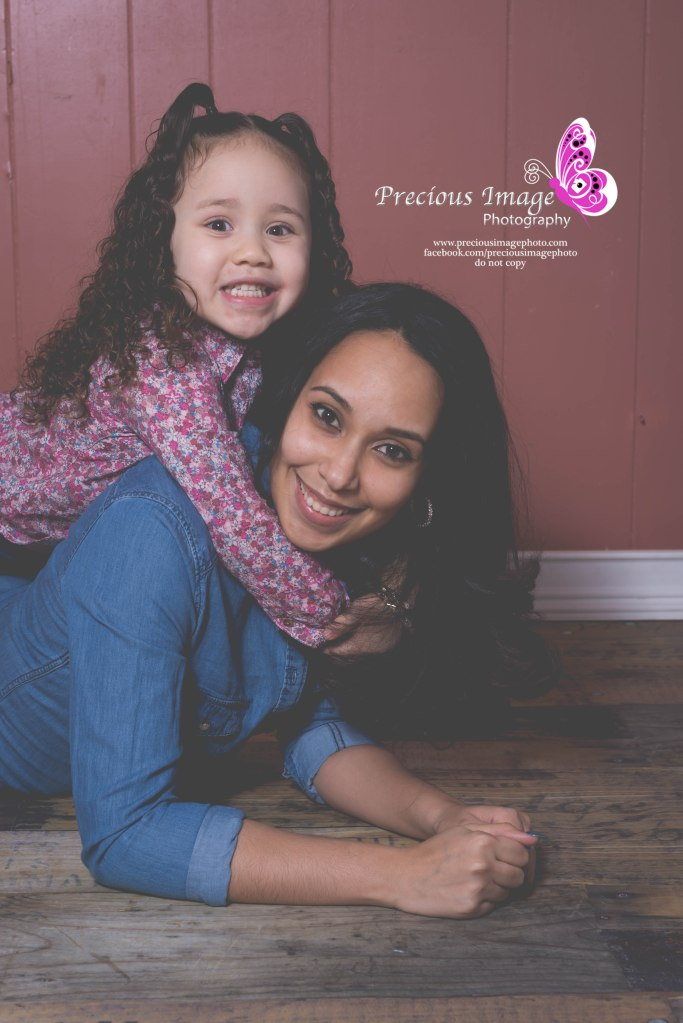 mom and daugher posing on wood floor in lancaster, pa