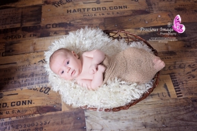 baby in basket on wood floor in quarryville, pa