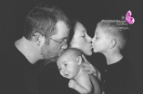 family kissing with baby in quarryville, pa