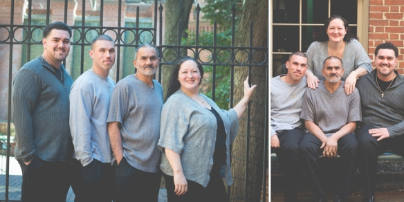 family standing in front of iron gate
