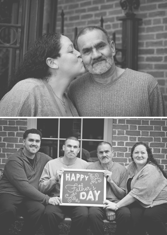 daughter kissing dad and family posing with sign