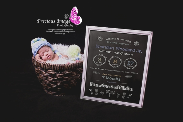 newborn in chalkboard with  birth information